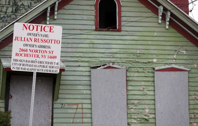 The city erects signs identifying the owners of some dilapidated houses, like this one on Orange Street in 2017. (Mark Mulville/News file photo)
