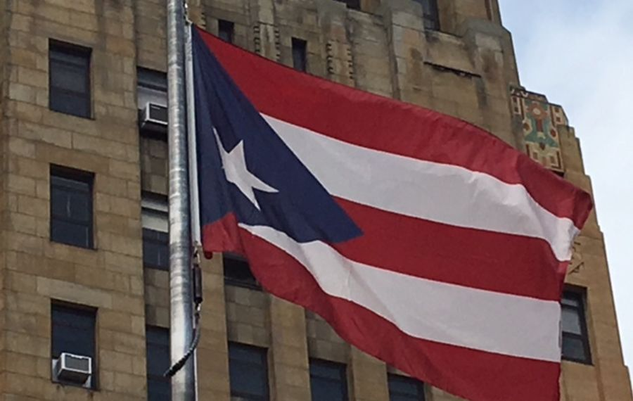 The Puerto Rican flag was ceremoniously hoisted in front of Buffalo City Hall in August 2018 to kick off Puerto Rican and Hispanic Heritage Week in Buffalo. (News file photo)