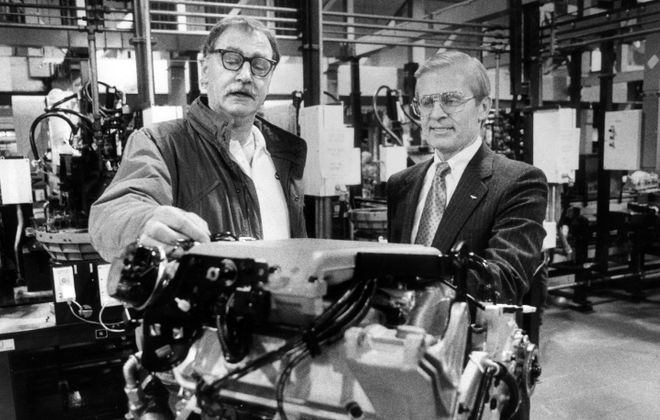 Donald L. Rust (right) with a new V-6 engine in 1987. At left is shop chairman Ken Kaiser. (News file photo)