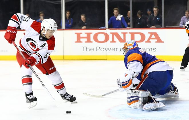 Jeff Skinner scores on a penalty shot against the Islanders (Al Bello/Getty Images)
