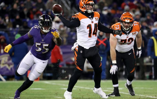 Quarterback Andy Dalton throws the game-winning pass against the Ravens. (Rob Carr/Getty Images file photo)