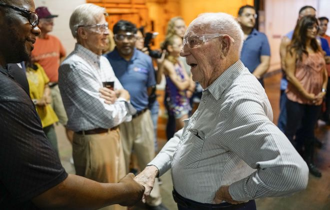 100-year-old George Nash, right, who was one of the first employees of the GM Tonawanda Engine Plant when he started work there in 1938, mingles during an open house for employees, families and retirees at the plant to commemorate the plant's 80th anniversary. (Derek Gee/Buffalo News)