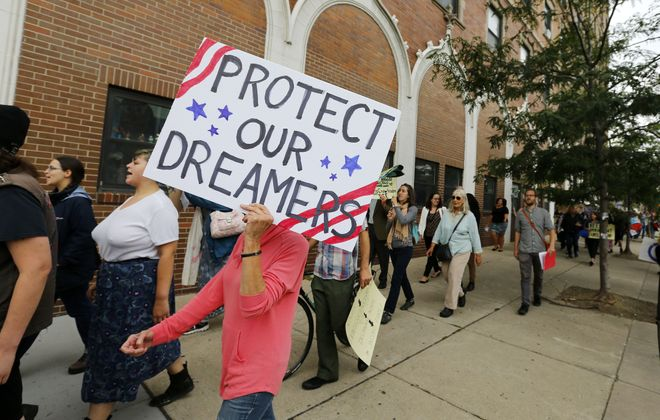 Members of Justice for Migrant Families, shown here during a 2017 protest, held a rally Tuesday for immigrant rights. (Mark Mulville/News file photo)