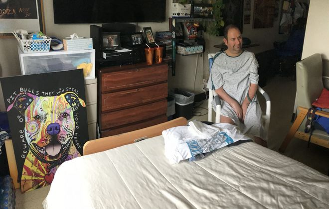Daniel Tracy, who has Lou Gehrig's disease, sits in his room at Emerald South, one of the most troubled nursing homes in the Buffalo region, on Aug. 14, 2018. (Robert Kirkham/Buffalo News)