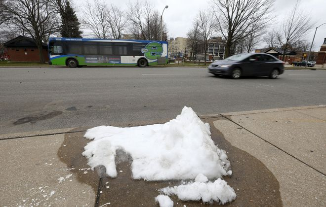 Snow slowly melts on North Park Row in downtown Erie, Pa., on Thursday, April 19, 2018. (Mark Mulville/Buffalo News)