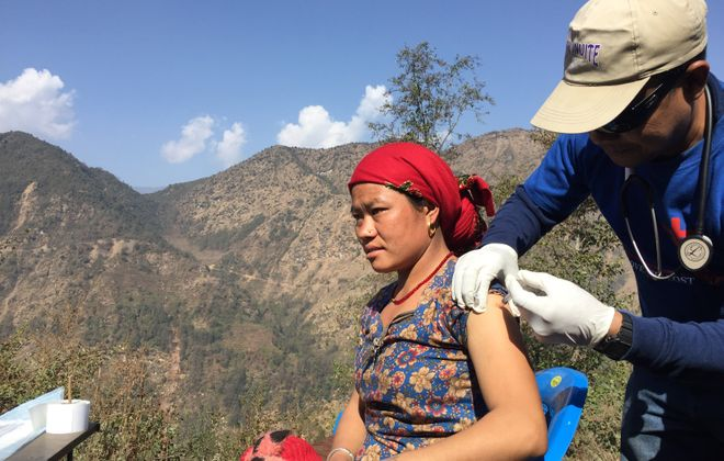 A member of Jericho Road Community Health Center's team in Nepal treats a patient in the remote village of Hagam in February 2017. (Jericho Road photo)