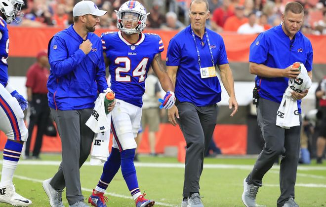 Buffalo Bills Taron Johnson is helped off the field against the Cleveland Browns during first quarter action last week. (Harry Scull Jr./ Buffalo News)