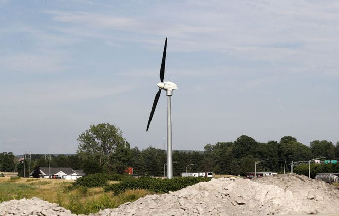 Just a few years after the New York State Thruway Authority spent about $5 million on five wind turbines, four of them stand dormant. This is the wind turbine at Thruway Exit 59 at Fredonia. (Mark Mulville/Buffalo News)