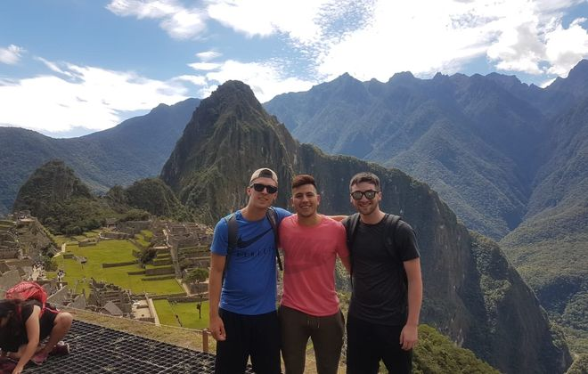Connor Lynskey (left) with his friend Manuel Zevallos (center) and another friend, Tommy Heslin, earlier this summer, Machu Picchu, Peru. (Image courtesy Manuel Zevallos Villanueva)