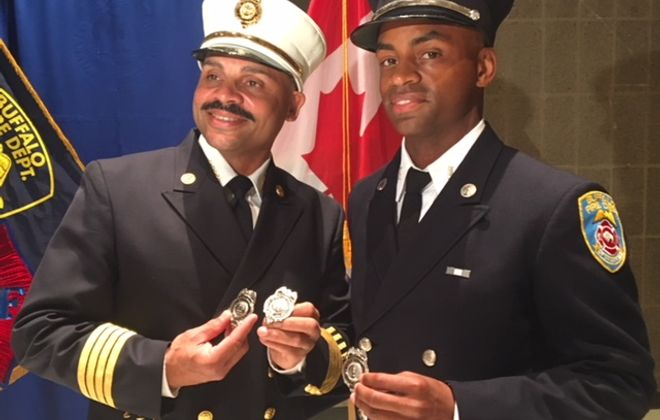 Deputy Fire Commissioner Ramon Suarez Sr. , left, was promoted to captain on the same day his son, Ramon Jr., was promoted to lieutenant.