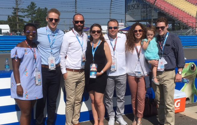 Honorary pace car driver Steve Tasker, fourth from right, with his family at The Glen Sunday morning.