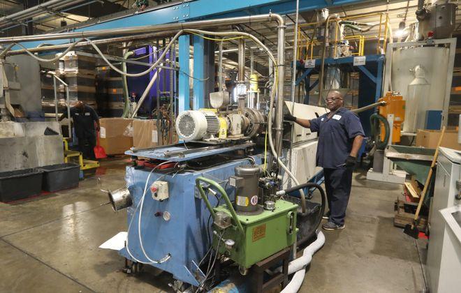 Laverne Morgan, an extrusion operator, works  at Tulip Molded Plastics on Highland Avenue in Niagara Falls. (John Hickey/News file photo)