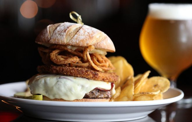 Cask + Cow's Maverick is a Black Angus burger topped with provolone, fried capicola, crispy onions, panko-crusted Hungarian pepper spread and garlic truffle aioli. (Sharon Cantillon/Buffalo News)