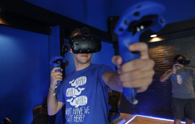 Vivid VR Gaming provides an immersive video game experience. (Robert Kirkham/Buffalo News)