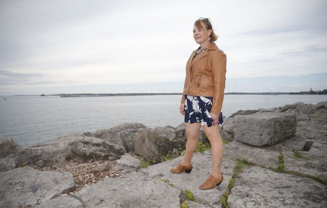Erin Parisi revisits the breakwater at Erie Basin Marina, where she made the decision to transition into a female during long walks along Buffalo's waterfront. (Robert Kirkham/Buffalo News)