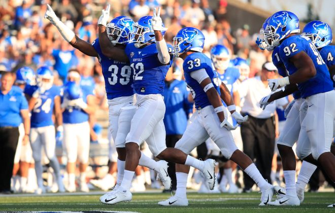 University at Buffalo defensive back Devon Russell celebrates an interception. (Harry Scull Jr./Buffalo News)