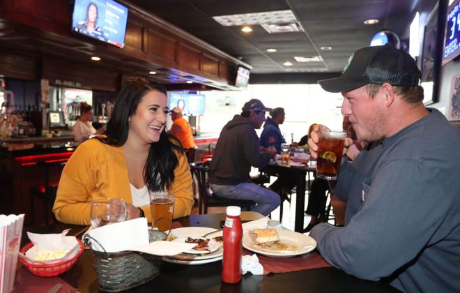 Brianna Gimbrone celebrates her birthday with her family and boyfriend Bobby Fisher at Pamp's Red Zone. (Sharon Cantillon/Buffalo News)