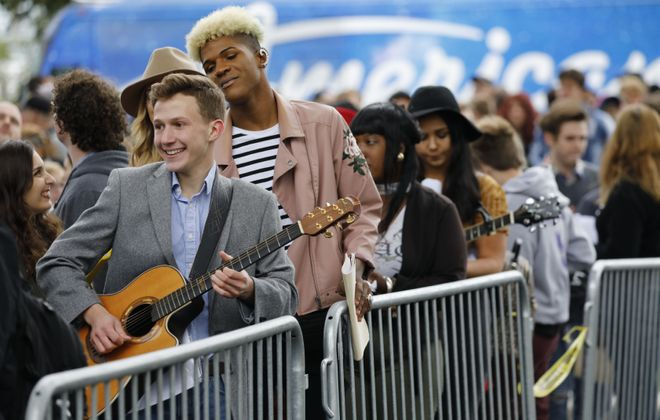 John Cimino of Lewiston plays guitar as he waits in line to audition for American Idol at Canalside, onSunday, Sept. 9, 2018. (Derek Gee/Buffalo News)
