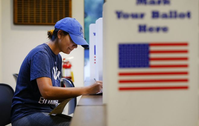 Bella Acosta fills out a ballot during primary day voting at St. Martins Church in South Buffalo on Thursday.   (Mark Mulville/Buffalo News)