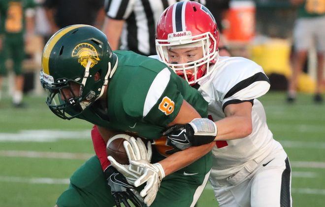 Lancaster's Nick Meara tackles Williamsville North's Dylan Kelly in the first quarter at Williamsville North high school in Williamsville, NY on Friday, Sept. 14, 2018. (James P. McCoy/News file photo)
