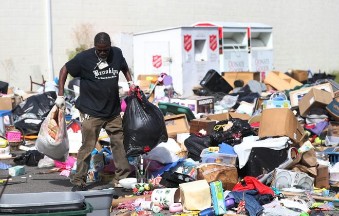 Driver Michael Brooks loads up a truck at the Salvation Army store in North Tonawanda. (Sharon Cantillon/News file photo)