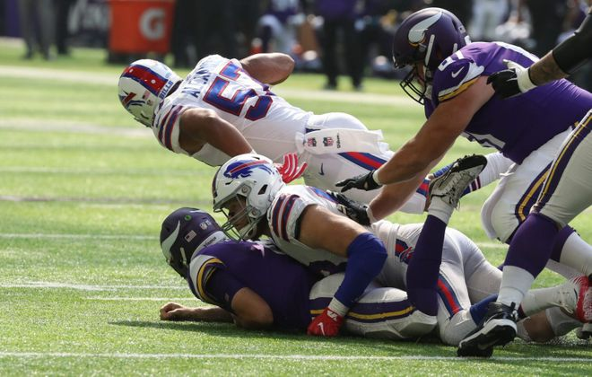 Trent Murphy sacks and forces a fumble by  Vikings quarterback Kirk Cousins during last Sunday's game. (James P. McCoy/News file photo)
