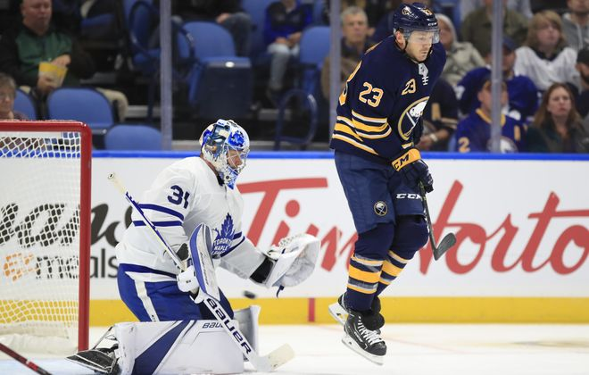 In his first game of the preseason, Sabres winger Sam Reinhart screens Toronto goaltender Frederik Anderson on Kyle Okposo's first-period goal. (Harry Scull Jr./Buffalo News).