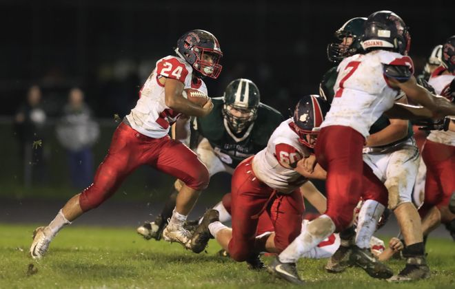 Southwestern running back Alex Card runs for yardage during the Trojans' win at Allegany-Limestone last Friday. Unbeaten Southwestern held its spot at No. 3 in the Buffalo News' Small Schools Poll. (Harry Scull Jr./Buffalo News)