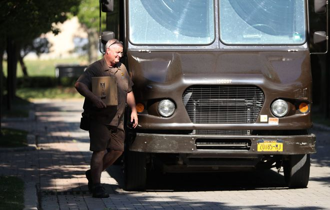 Matt Riter, 30-year employee for UPS, delivers packages Friday in Buffalo. (Sharon Cantillon/Buffalo News)