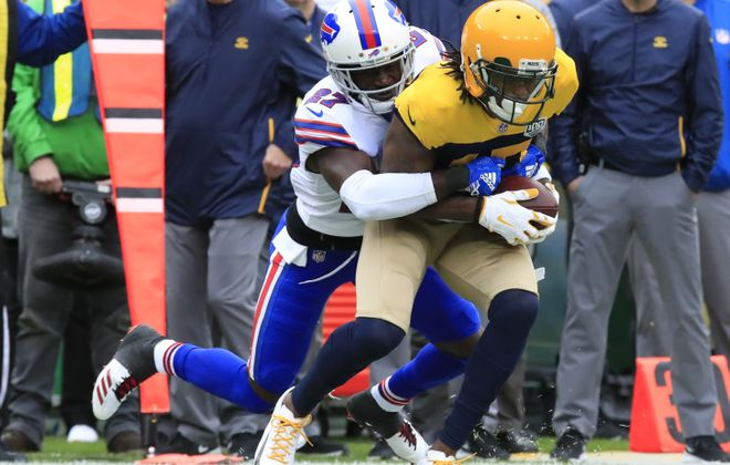 Tre'Davious White tackles Green Bay Packers receiver Davante Adams (Harry Scull Jr./ Buffalo News)