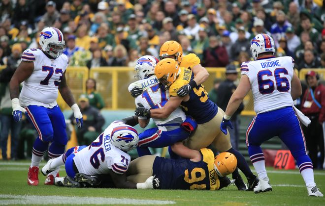 Buffalo Bills linemen watch as quarterback Josh Allen is sacked Sunday against the Packers. (Harry Scull Jr./ Buffalo News)