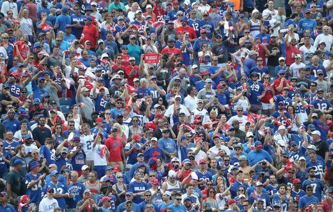 Buffalo Bills fans cheer on the team in the first quarter. (James P. McCoy/Buffalo News)