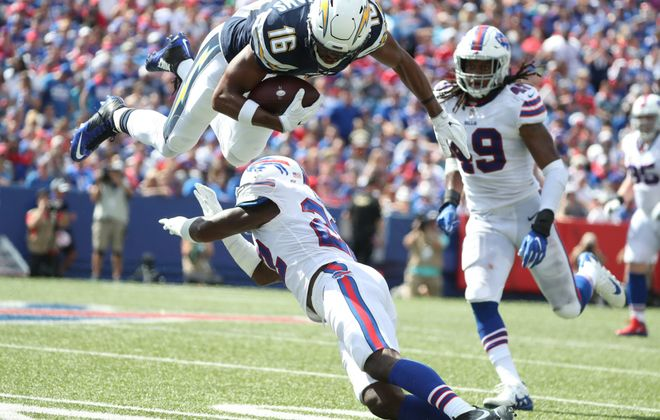 Chargers receiver Tyrell Williams is tackled by Vontae Davis during a game in Orchard Park in September. (James P. McCoy/Buffalo News)