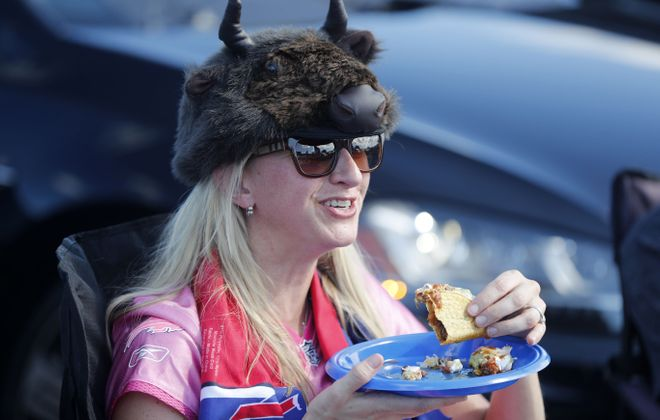 Chris Cole-Blue enjoys a taco in the parking lot before the Bills game at New Era Field in Orchard Park on Sunday, Sept. 16, 2018. (Mark Mulville/Buffalo News)