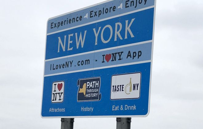 One of the controversial New York State signs near the blue water tower in Amherst. (Robert Kirkham/Buffalo News)