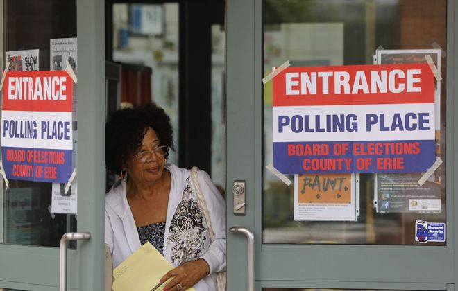 Eleanor Gayles-Davis emerges from the Delevan-Grider Community Center after casting her vote in the primary election on Thursday, Sept. 13, 2018. (Derek Gee/Buffalo News)