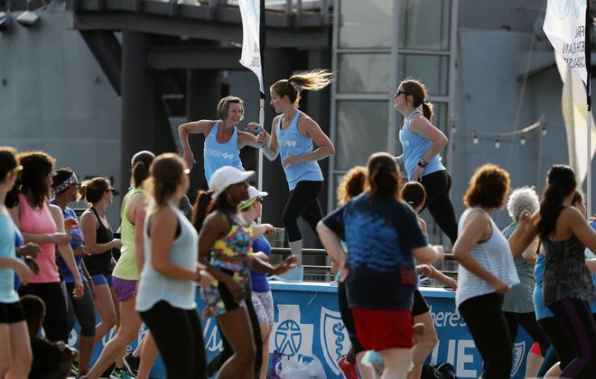 Canalside's popular Zumba teachers will return to the venue on Sunday morning for one more outdoor fitness class this summer. (Mark Mulville/Buffalo News)