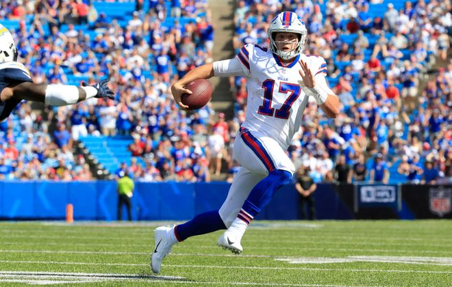 Buffalo Bills quarterback Josh Allen runs with the ball against the Los Angeles Chargers during the third quarter at New Era Field in Orchard Park, Sunday, Sept. 16, 2018. (Harry Scull Jr./Buffalo News)