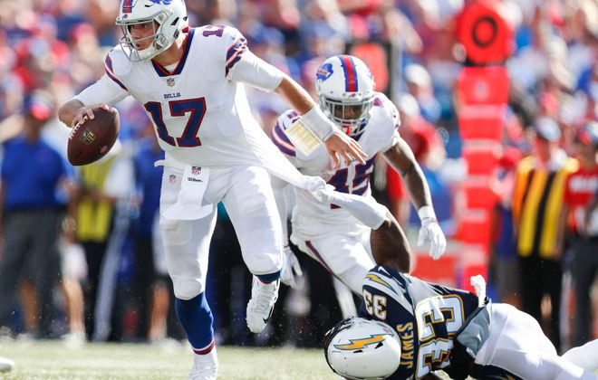 Josh Allen slipped away from blitzing Chargers safety Derwin James on this third-quarter play. (Mark Mulville/Buffalo News)