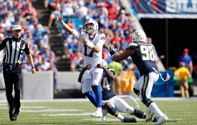 Bills quarterback Josh Allen got hit early and often in his first career start. (Mark Mulville/Buffalo News)