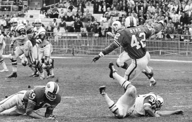 Butch Byrd. a Buffalo Bills defensive back, intercepts New York Jets quarterback Joe Namath on Sept. 29, 1968, in the Bills' 37-35 victory. It was the only game the Bills won that season. (News file photo)