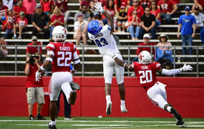 UB's Anthony Johnson catches a pass as Avery Young of the Rutgers Scarlet Knights defends and Damon Hayes looks on during the second quarter Sept. 22 at HighPoint.com Stadium in Piscataway, N.J. (Getty Images)