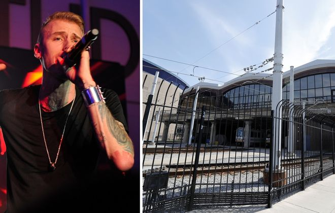 Cleveland rapper Machine Gun Kelly, left, raps in front of Buffalo's still-vacant DL&W Terminal. (John Sciulli/Getty Images)