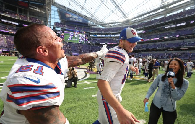 Safety Jordan Poyer congratulates Josh Allen after the Bills' 27-6 win over the Vikings in 2018. (James P. McCoy/Buffalo News)
