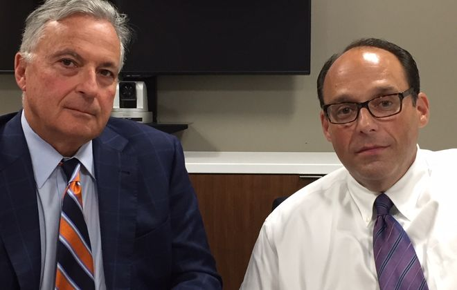 Andrew Shaevel, right, owner of Hylan Asset Management, and his attorney Dennis Vacco. (Dan Herbeck / Buffalo News)