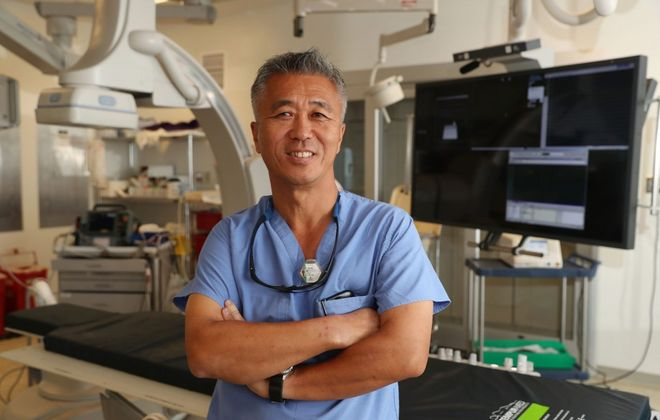 """An estimated 130,000 Americans die each year from atrial fibrillation, which Dr. Chee Kim treats at the Gates Vascular Institute on the Buffalo Niagara Medical Campus. """"Initially, it will be intermittent,"""" he says, """"so you'll have episodes that may last an hour and then your heart will correct itself. You may get it once a year. As time goes on, irregularities will become more frequent and more prolonged. """"(Sharon Cantillon/Buffalo News)"""