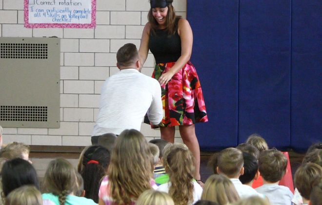The moment when Cory Martin surprised his girlfriend, Amanda Eichinger, by proposing to her at an assembly Monday at Edison Elementary School, where she teaches. (Photo courtesy Kenmore-Town of Tonawanda School District)
