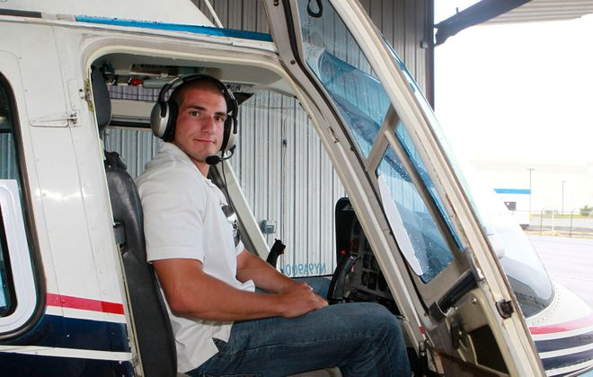 Helicopter Pilot Michael Campbell, 22, in 2013 after making an emergency landing on the Hudson River, poses for photos at Linden Airport located at 1101 W Edgar Rd in Linden, New Jersey. He was arrested Saturday after police found two kilos of cocaine in his car when he was stopped in a parking lot in North Buffalo. (Anthony DelMundo/New York Daily News)