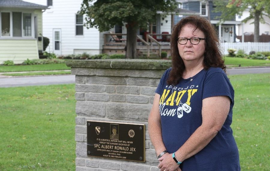 Cathy MacFarlane stands next to a plaque in Veterans Park in Lockport honoring her son, Spc. Albert R. Jex, the only Lockport resident killed in action in Iraq.  (John Hickey/Buffalo News)