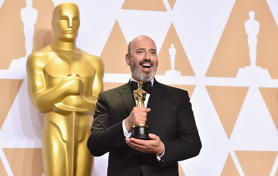 """Niagara Falls native and costume designer Mark Bridges, poses with his Oscar for Best Costume Design on """"Phantom Thread."""" He will be honored at the Niagara Falls International Film Festival. (Getty Images)"""